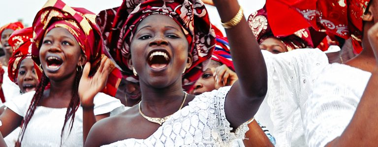African women celebrating in traditional clothing